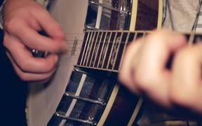 Man Playing the Banjo Close Up