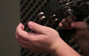 Musician Plays a Tambourine Close Up