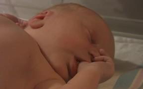 Thumb Sucking Newborn Baby (2h old)